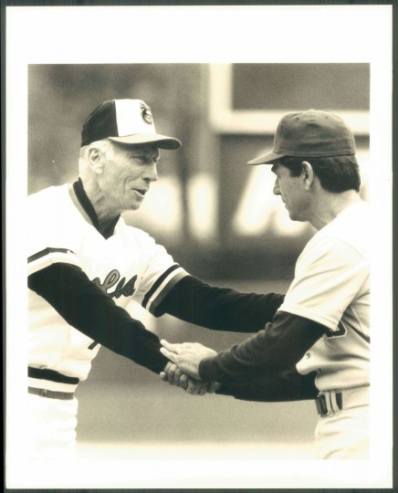 Cal Ripken Sr. greets another baseball coach. (Baltimore Sun photo)