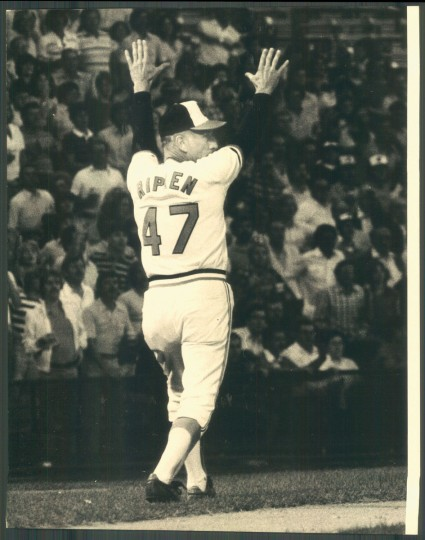 Cal Ripken Sr. holds up Kiko Garcia at third. (Baltimore Sun photo by Irving H. Phillips)