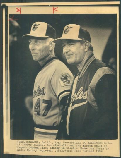 Cal Ripken Sr. and Joe Altobelli smile as Eddie Murray hits a home run on Aug. 25, 1984. (Baltimore Sun photo)
