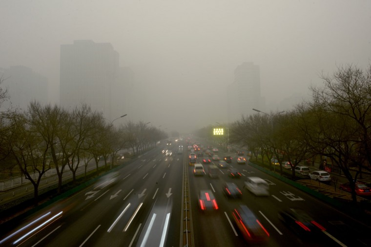 Commuters drive on a road in heavy pollution in Beijing on December 1, 2015. Beijing ordered hundreds of factories to shut and allowed children to skip school as choking smog reached over 25 times safe levels on December 1, casting a cloud over China's participation in Paris climate talks. (WANG ZHAO/AFP/Getty Images)