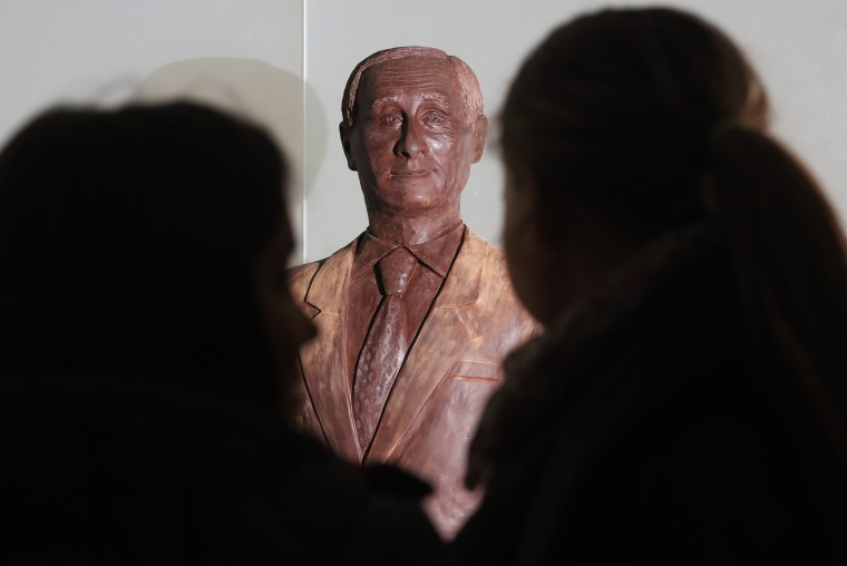 Visitor examine a chocolate statue of Russian President Vladimir Putin during the Chocolate Festival in St.Petersburg, Russia, Saturday, Dec. 5, 2015. The life-sized chocolate sculpture was created by Russian sculptor Nikita Gusev. (AP Photo/Dmitry Lovetsky)