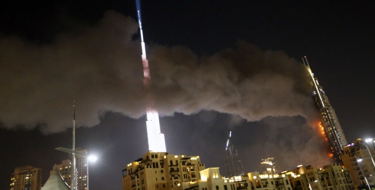 A picture taken on December 31, 2015 the Address Downtown hotel burning after huge fire ripped through the luxury hotel near the world's tallest tower, in Dubai. People were gathering to watch New Year's Eve celebrations when the hotel caught on fire without causing casualties, according to authorities. (KARIM SAHIB/AFP/Getty Images)