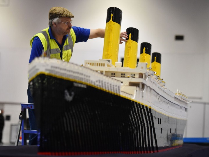 An exhibitor puts the finishing touches to a model of the Titanic made from Lego for the Brick 2015 exhibition at the ExCel in London on December 10, 2015. (BEN STANSALL/AFP/Getty Images)
