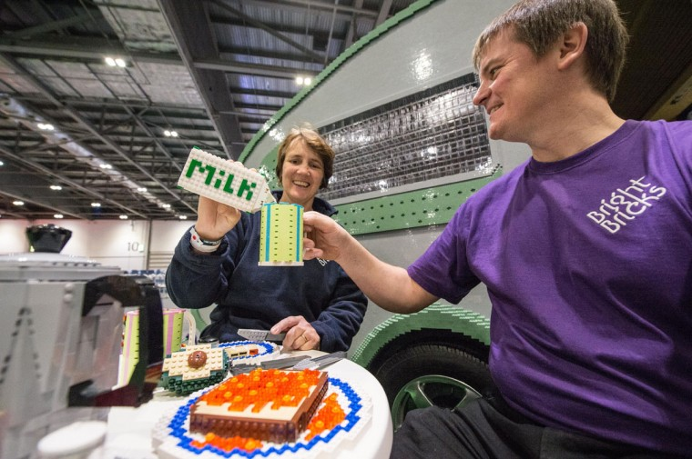 Annie Diment and Ed Diment enjoy a Lego lunch outside the caravan they built entirely from Legos with 215,158 bricks and over 1,000 hours at ExCel on December 10, 2015 in London, England. (Photo by Chris Ratcliffe/Getty Images)
