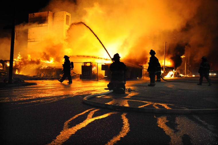 Baltimore firefighters battle a three-alarm fire at Gay and Chester Streets in East Baltimore. It was unclear whether is was related to the ongoing riots. (Jerry Jackson/Baltimore Sun)