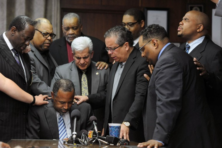 Third from right, Bishop Angel Nunez, pastor of the Bilingual Christian Church and president of the Multicultural Prayer Movement, leads a prayer for Dr. Ben Carson at the Bilingual Christian Church as he makes the first of two Baltimore appearances Thursday. Carson said on Monday that he will seek the Republican presidential nomination. (Kim Hairston/Baltimore Sun)
