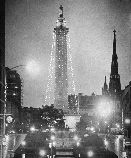 In December of 1975 the Washington Monument was decorated with Christmas lights. Mount Vernon Place Methodist Church stands out in the early morning sky in this view from Charles Street looking north. (Clarence B. Garrett/Baltimore Sun)