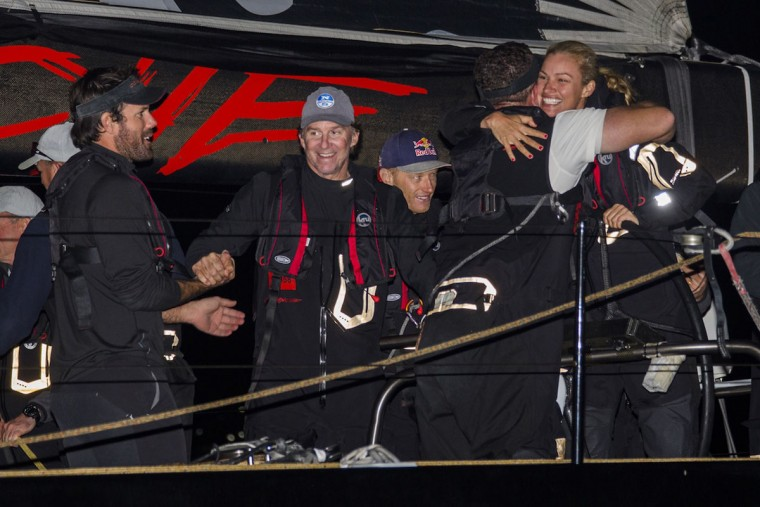 In this handout photo released by Rolex, owner Kristy Hinze-Clark celebrates with her crew after their US supermaxi yacht Comanchi won the Sydney to Hobart yacht race, in Hobart on December 28, 2015. (STEFANO GATTINI/AFP/Getty Images)