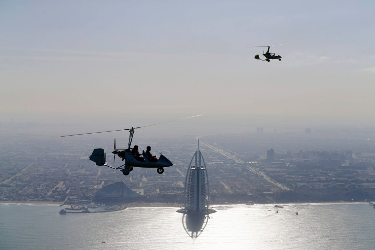 Gyrocopters fly over the capital of the United Arab Emirates, Dubai, during the World Air Games 2015, on December 9, 2015. (KARIM SAHIB/AFP/Getty Images)