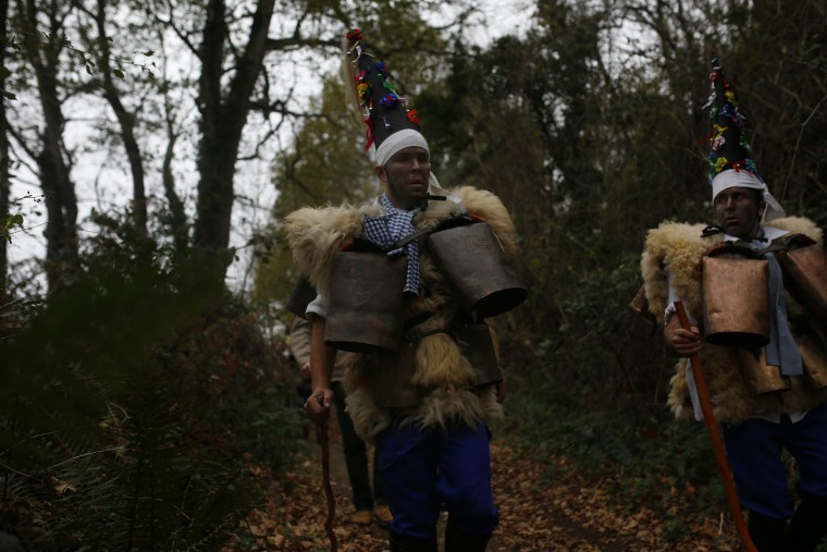 "Men dressed in sheepskins and jingling bells to make noise, and so called ""Zamarracos"" march during the Vijanera Festival, in the small village of Silio, northern Spain, Sunday, Jan. 3, 2016. The Vijanera masquerade, of pre-Roman origin, is the first carnival of the year in Europe symbolizing the triumph of good over evil and involving the participation of crowds of residents wearing different masks, animal skins and brightly coloured clothing with its own complex function and symbolism and becoming the living example of the survival of archaic cults to nature. (AP Photo/Francisco Seco)"
