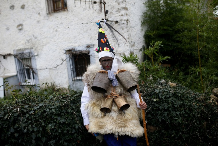 "A man dressed in sheepskins with jingling bells to make noise, and so called ""Zamarraco,"" poses for a photograph during the Vijanera Festival, in the small village of Silio, northern Spain, Sunday, Jan. 3, 2016. The Vijanera masquerade, of pre-Roman origin, is the first carnival of the year in Europe symbolizing the triumph of good over evil and involving the participation of crowds of residents wearing different masks, animal skins and brightly coloured clothing with its own complex function and symbolism and becoming the living example of the survival of archaic cults to nature. (AP Photo/Francisco Seco)"