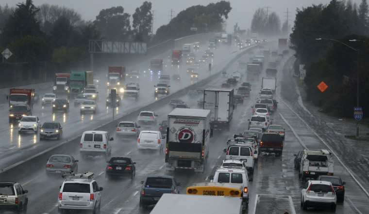 Vehicles slow on Interstate 80 during a winter rain storm Tuesday, Jan 5, 2016, in San Leandro, Calif. El Nino storms lined up in the Pacific, promising to drench parts of the West for more than two weeks and increasing fears of mudslides and flash floods in regions stripped bare by wildfires. At least two more storms are expected to follow on Wednesday and Thursday, bringing as much as 3 inches of rain. (AP Photo/Ben Margot)