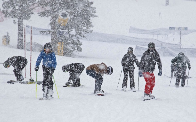 In this photo provided by Northstar California Resort, skiers and riders make their way to the Zephyr Express high-speed chair at Northstar California, Tuesday, Jan. 5, 2016, in Truckee, Calif. Californians were warned against abandoning conservation efforts Tuesday as several weeks of storms spawned by El Nino began hitting the West Coast. (Northstar California Resort via AP)
