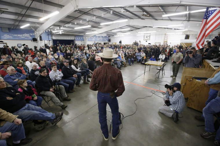 Jesse Svejcar expresses his opinion during a community meeting with Harney County Sheriff David Ward, right, Wednesday, Jan. 6, 2016, in Burns, Ore. With the takeover entering its fourth day Wednesday, authorities had not removed the armed group occupying the Malheur National Wildlife Refuge in eastern Oregon's high desert country. (AP Photo/Rick Bowmer)