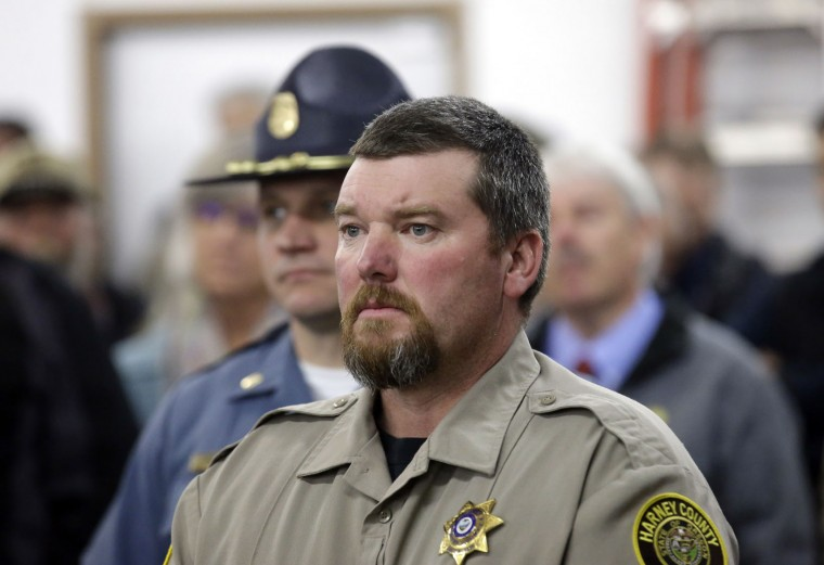 Harney County Sheriff David Ward arrives to a community meeting at the Harney County fairgrounds Wednesday, Jan. 6, 2016, in Burns, Ore. With the takeover entering its fourth day Wednesday, authorities had not removed the group of roughly 20 people from the Malheur National Wildlife Refuge in eastern Oregon's high desert country. (AP Photo/Rick Bowmer)