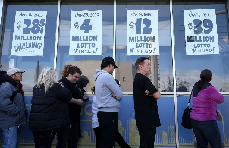 People line up to buy Powerball tickets at Kavanagh Liquors on January 13, 2016 in San Lorenzo, California. Dozens of people lined up outside of Kavanagh Liquors, a store that has had several multi-million dollar winners, to -purchase Powerball tickets in hopes of winning the estimated record-breaking $1.5 billion dollar jackpot. (Justin Sullivan/Getty Images)