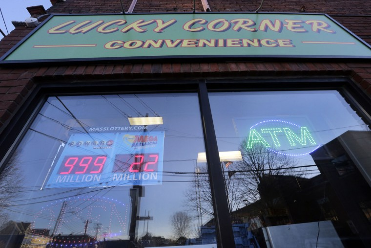 The digital sign at the Lucky Corner Convenience Store in Somerville, Mass., Wednesday, Jan. 13, 2016 doesn't have the capacity to reflect the Powerball jackpot for Wednesday night's drawing which is estimated to be more than $1 billion, the largest lottery jackpot in the world. (AP Photo/Elise Amendola)