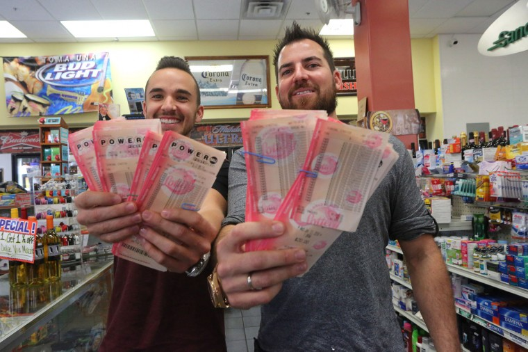 Ryan McGuinness, left, and Shane Krugman display 3,000 Powerball lottery tickets that they had purchased from the Metro Market, Wednesday, Jan. 13, 2016, in Tampa. The two Tampa men have organized a lottery pool that has about 270 participants who have chipped in at least $500 and bought more than 67,000 tickets. The Powerball jackpot for Wednesday night's drawing is at least $1.5 billion, the largest lottery jackpot in the world. (Skip O'Rourke/The Tampa Bay Times via AP)