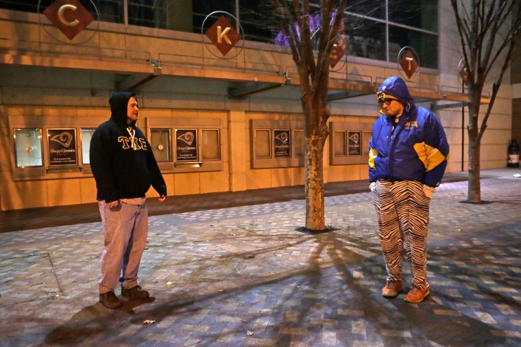 Zach Remelius, left, Mickey Right stand outside the Edward Jones Dome on Tuesday, Jan. 12, 2016, in St. Louis. NFL owners voted Tuesday night to allow the St. Louis Rams to move to a new stadium at a site just outside Los Angeles, and the San Diego Chargers will have an option to share the facility. (Cristina M. Fletes/St. Louis Post-Dispatch via AP)