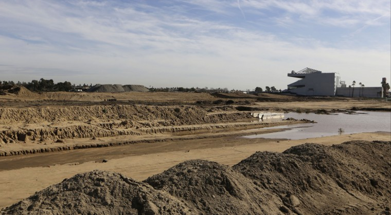 The Hollywood Park Casino, right, stands near the site of the future stadium for NFL football's Rams, at the the former Hollywood Park in Inglewood, Calif., on Wednesday, Jan. 13, 2016. League owners voted Tuesday to allow the Rams to move to Los Angeles starting next season. (AP Photo/Damian Dovarganes)