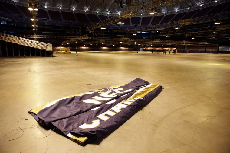 An NFC Championship banner sits on the floor after being removed from the ceiling of the Edward Jones Dome, former home of the St. Louis Rams football team, Thursday, Jan. 14, 2016, in St. Louis. The Rams will begin playing in Los Angeles starting with the 2016 season. (AP Photo/Jeff Roberson)