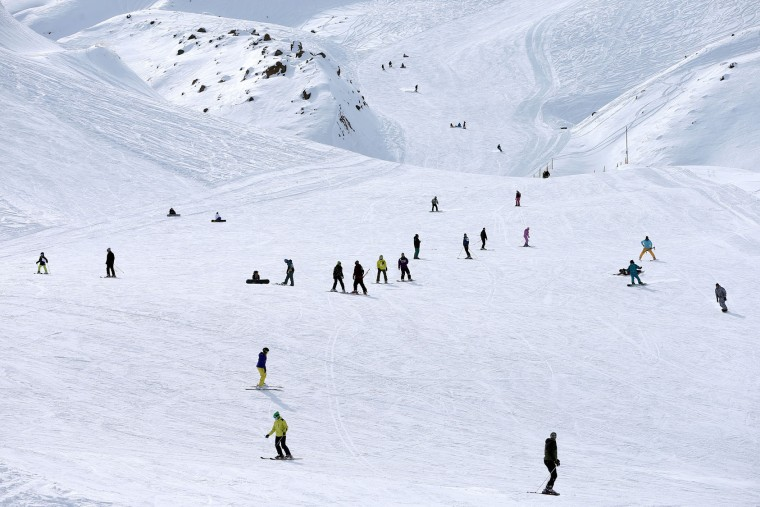 In this Friday, Jan. 15, 2016 photo, Iranian skiers descend from a slope at Dizin ski resort some 72 kilometers (45 miles) north of the capital Tehran, Iran. Every weekend, Dizin ski resort in Alborz mountain range, north of Tehran, draws hundreds of skiers from the capital and other towns. (AP Photo/Ebrahim Noroozi)