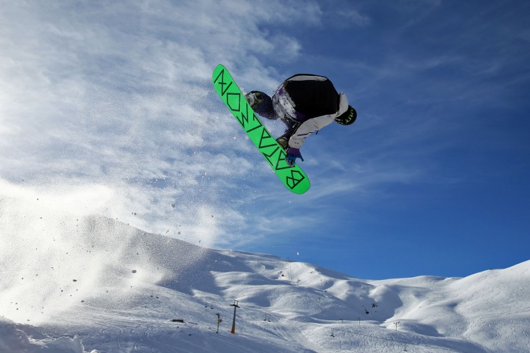 In this Friday, Jan. 15, 2016 photo, an Iranian snowboarder trains at Dizin Ski Resort some 72 kilometers (45 miles) north of the capital Tehran, Iran. Every weekend, Dizin ski resort in Alborz mountain range, north of Tehran, draws hundreds of holidaymakers from the capital and other towns. (AP Photo/Ebrahim Noroozi)