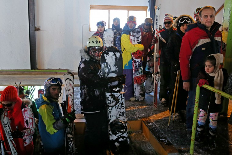 In this Friday, Jan. 15, 2016 photo, Iranian skiers wait in line to board chairlifts at Dizin Ski Resort some 72 kilometers (45 miles) north of the capital Tehran, Iran. Every weekend, the resort in the Alborz mountain range, north of Tehran, draws hundreds of skiers from the capital and other towns. (AP Photo/Ebrahim Noroozi)