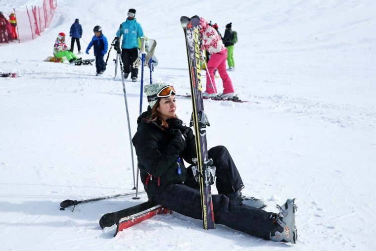 In this Friday, Jan. 15, 2016 photo, an Iranian skier rests at Dizin Ski Resort some 72 kilometers (45 miles) north of the capital Tehran, Iran. Every weekend, the resort in the Alborz mountain range, north of Tehran, draws hundreds of skiers from the capital and other towns. (AP Photo/Ebrahim Noroozi)