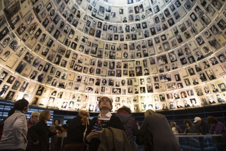 Israelis visit the Hall of Names at the Yad Vashem Holocaust museum, which commemorates the six million Jews killed by the Nazis during World War II on January 27, 2014 in Jerusalem, Israel. The international Holocaust Remembrance Day is marked today around the globe. (Photo by Uriel Sinai/Getty Images)