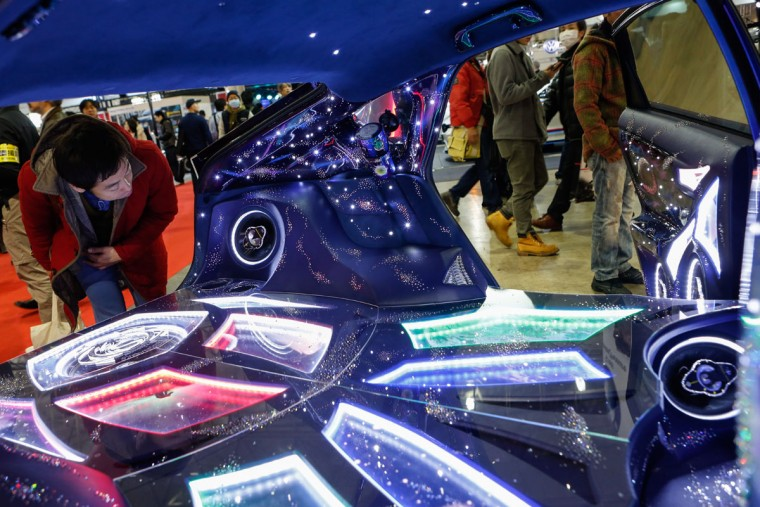 A visitor looks at the custom audio system inside the interior of a car shown on display at the 2016 Tokyo Auto Salon car show on January 15, 2016 in Chiba, Japan. (Photo by Christopher Jue/Getty Images)