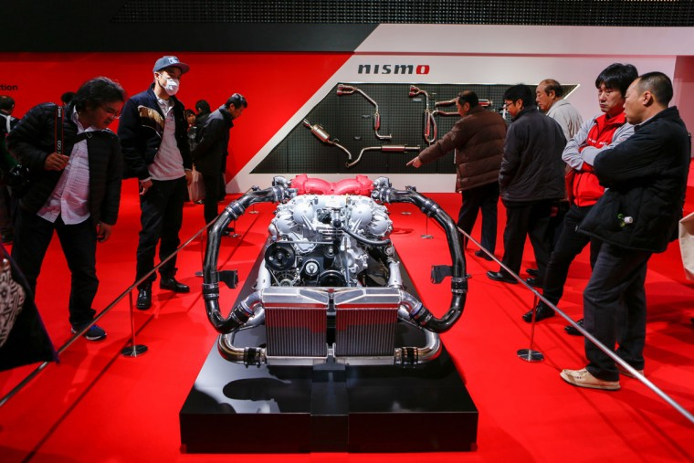 Visitors look at a custom Nissan NISMO engine system shown on display at the 2016 Tokyo Auto Salon car show on January 15, 2016 in Chiba, Japan. TOKYO AUTO SALON 2016 is held from January 15 to 17, 2016. (Photo by Christopher Jue/Getty Images)