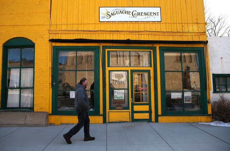 Saguache Crescent owner and editor Dean Coombs walks into the newspaper office on January 19, 2016 in Saguache, Colorado. The Saguache Crescent newspaper is the last newspaper in the United States that is produced using a Linotype hot metal typesetting machine. Dean Coombs, the paper's owner and editor, has been publishing the small town newspaper once a week using a Linotype machine that was purchased new in 1921, a few years after his family took over the paper in 1917. Coombs has been running the business by himself for the past 38 years and has no plans of shutting its doors anytime soon. Most newspapers discontinued the use of Linotypes over 40 years ago and were replaced with offset lithography printing and computer typesetting. (Photo by Justin Sullivan/Getty Images)
