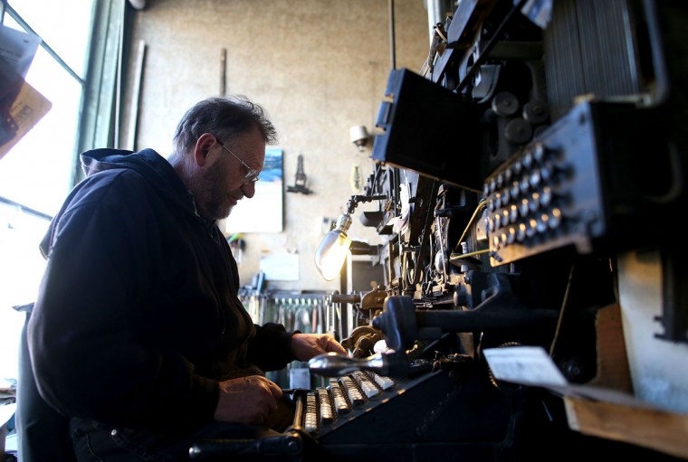 Saguache Crescent owner and editor Dean Coombs operates a vintage hot metal Linotype typesetting machine as he creates metal type slugs to be used to print the Saguache Crescent newspaper on January 18, 2016 in Saguache, Colorado. The Saguache Crescent newspaper is the last newspaper in the United States that is produced using a Linotype hot metal typesetting machine. Dean Coombs, the paper's owner and editor, has been publishing the small town newspaper once a week using a Linotype machine that was purchased new in 1921, a few years after his family took over the paper in 1917. Coombs has been running the business by himself for the past 38 years and has no plans of shutting its doors anytime soon. Most newspapers discontinued the use of Linotypes over 40 years ago and were replaced with offset lithography printing and computer typesetting. (Photo by Justin Sullivan/Getty Images)