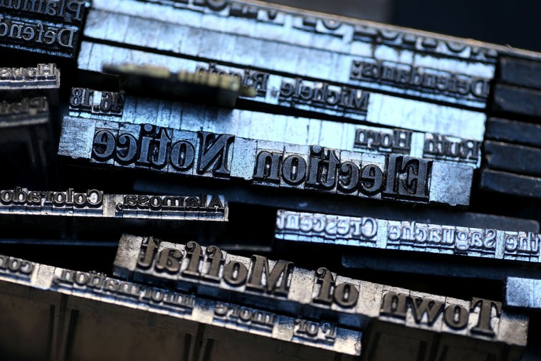 Metal type slugs that were created using a Linotype hot metal typesetting maching sit on a shelf inside the offices of the Saguache Crescent newspaper on January 18, 2016 in Saguache, Colorado. The Saguache Crescent newspaper is the last newspaper in the United States that is produced using a Linotype hot metal typesetting machine. Dean Coombs, the paper's owner and editor, has been publishing the small town newspaper once a week using a Linotype machine that was purchased new in 1921, a few years after his family took over the paper in 1917. Coombs has been running the business by himself for the past 38 years and has no plans of shutting its doors anytime soon. Most newspapers discontinued the use of Linotypes over 40 years ago and were replaced with offset lithography printing and computer typesetting. (Photo by Justin Sullivan/Getty Images)