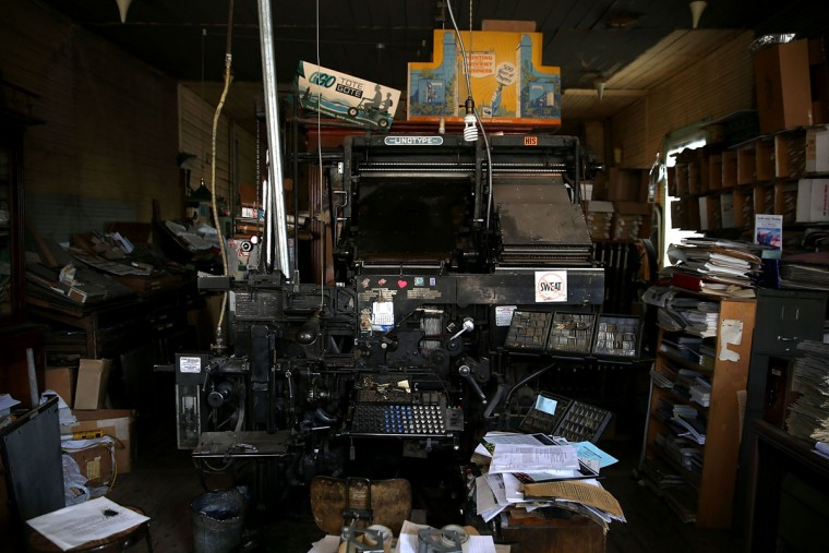 A view of a vintage hot metal Linotype typesetting machine at the Saguache Crescent newspaper on January 18, 2016 in Saguache, Colorado. The Saguache Crescent newspaper is the last newspaper in the United States that is produced using a Linotype hot metal typesetting machine. Dean Coombs, the paper's owner and editor, has been publishing the small town newspaper once a week using a Linotype machine that was purchased new in 1921, a few years after his family took over the paper in 1917. Coombs has been running the business by himself for the past 38 years and has no plans of shutting its doors anytime soon. Most newspapers discontinued the use of Linotypes over 40 years ago and were replaced with offset lithography printing and computer typesetting. (Photo by Justin Sullivan/Getty Images)