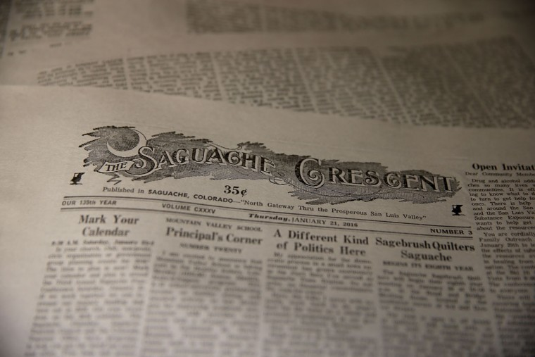 A freshly printed copies of the Saguache Crescent sit on a table at the Saguache Crescent on January 19, 2016 in Saguache, Colorado. The Saguache Crescent newspaper is the last newspaper in the United States that is produced using a Linotype hot metal typesetting machine. Dean Coombs, the paper's owner and editor, has been publishing the small town newspaper once a week using a Linotype machine that was purchased new in 1921, a few years after his family took over the paper in 1917. Coombs has been running the business by himself for the past 38 years and has no plans of shutting its doors anytime soon. Most newspapers discontinued the use of Linotypes over 40 years ago and were replaced with offset lithography printing and computer typesetting. (Photo by Justin Sullivan/Getty Images)