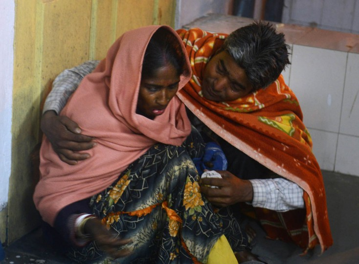 An injured Indian woman is comforted by her husband as she waits for treatment at Siliguri Hospital following an earthquake in Siliguri on January 4, 2016. A strong 6.7 magnitude earthquake struck northeast India near the country's borders with Myanmar and Bangladesh early on January 4, sending people fleeing into the streets with dozens injured in the panic. (Diptendu Dutta/AFP/Getty Images)
