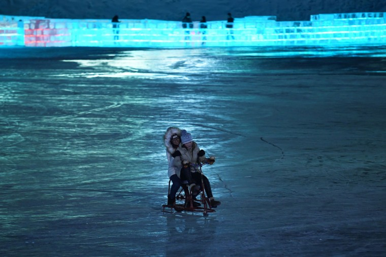 Two women ride a sleigh at the China Ice and Snow World on the eve of the opening ceremony of the Harbin International Ice and Snow Festival in Harbin, northeast China's Heilongjiang province on January 4, 2016. (WANG ZHAO/AFP/Getty Images)