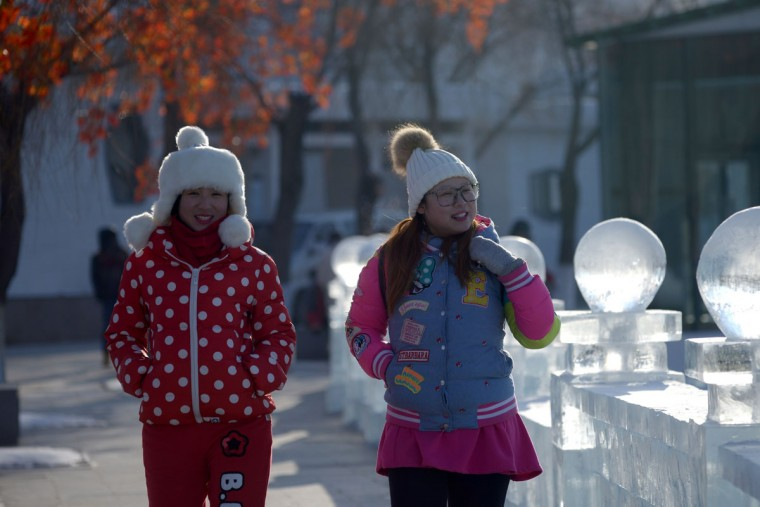 Visitors look at snow sculptures before the opening ceremony of the Harbin International Ice and Snow Festival in Harbin, northeast China's Heilongjiang province on January 4, 2016. (WANG ZHAO/AFP/Getty Images)