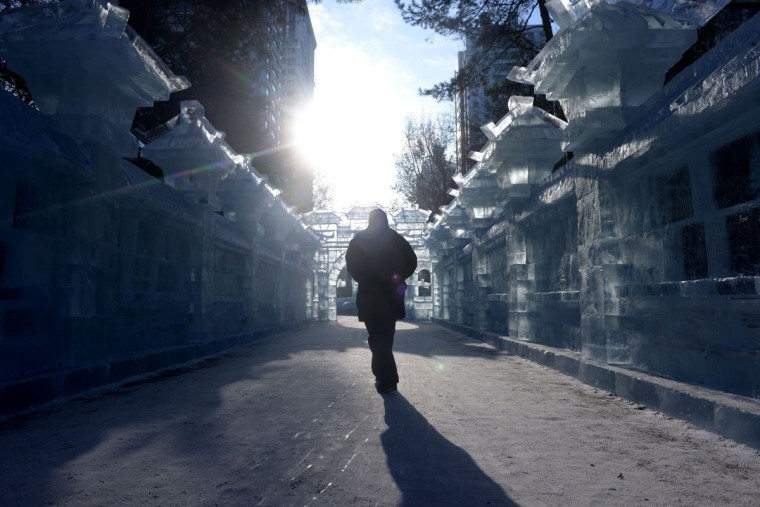 A man walks past ice sculptures at a park before the opening ceremony of the Harbin International Ice and Snow Festival in Harbin, northeast China's Heilongjiang province on January 4, 2016. (WANG ZHAO/AFP/Getty Images)