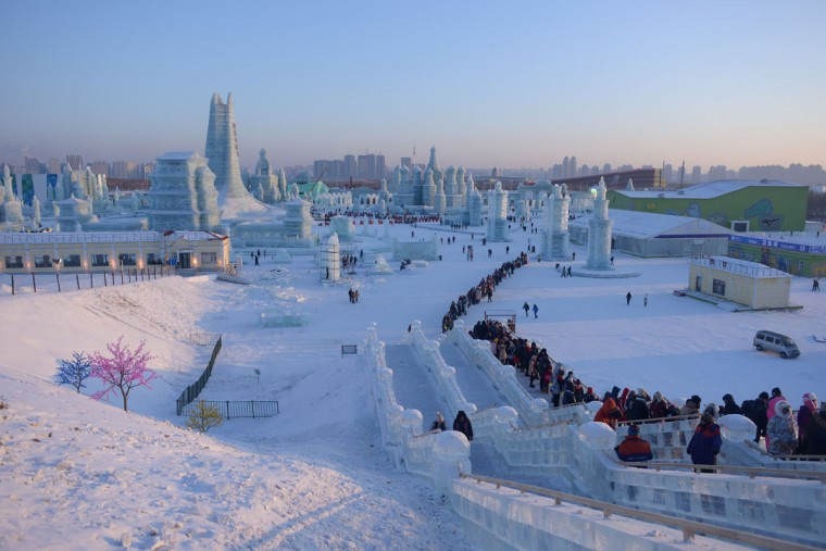 People wait in line at the China Ice and Snow World on the eve of the opening ceremony of the Harbin International Ice and Snow Festival in Harbin, northeast China's Heilongjiang province on January 4, 2016. (WANG ZHAO/AFP/Getty Images)