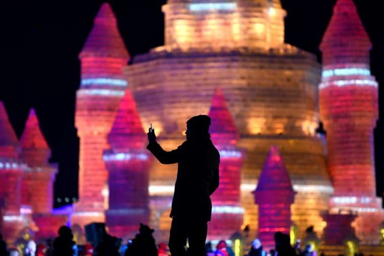 A man takes a photo in front of ice sculptures at the China Ice and Snow World on eve of the opening ceremony of the Harbin International Ice and Snow Festival in Harbin, northeast China's Heilongjiang province on January 4, 2016. (WANG ZHAO/AFP/Getty Images)