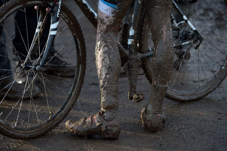 A rider is covered in mud after competing in the Men's Under-23 race of the 2016 British Cycling National Cyclo-Cross Championships at Shrewsbury Sports Village on January 10, 2016 in Shrewsbury, Central England. (OLI SCARFF/AFP/Getty Images)