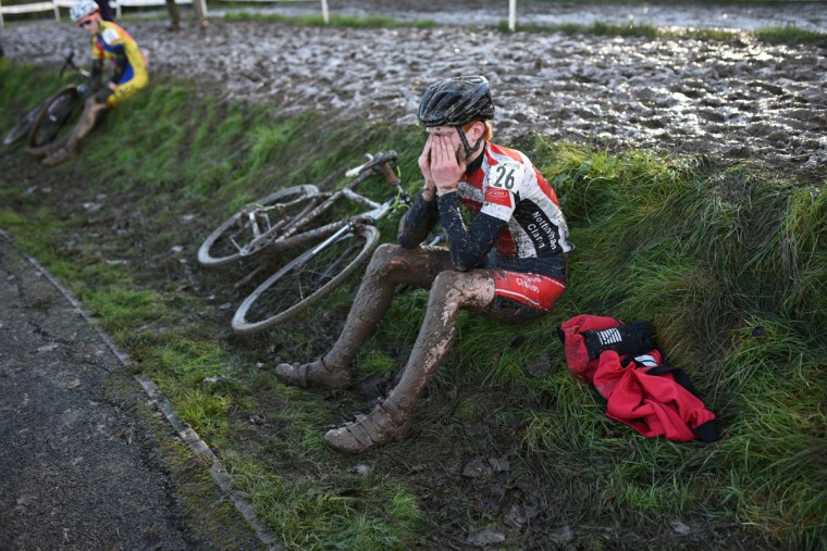 Rider Calum Fernie reacts after finishing the Junior Men's Championship of the 2016 British Cycling National Cyclo-Cross Championships at Shrewsbury Sports Village on January 10, 2016 in Shrewsbury, Central England. (OLI SCARFF/AFP/Getty Images)