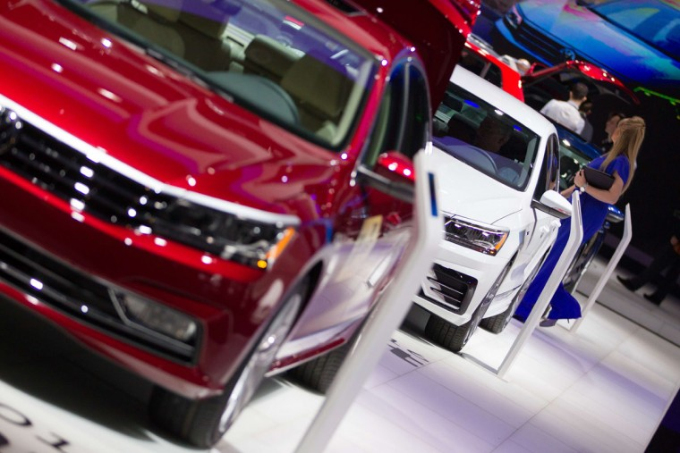 A line of Volkswagen Passat's are displayed at the Volkswagen booth at the 2016 North American International Auto Show in Detroit, Michigan, January 12, 2016. (GEOFF ROBINS/AFP/Getty Images)