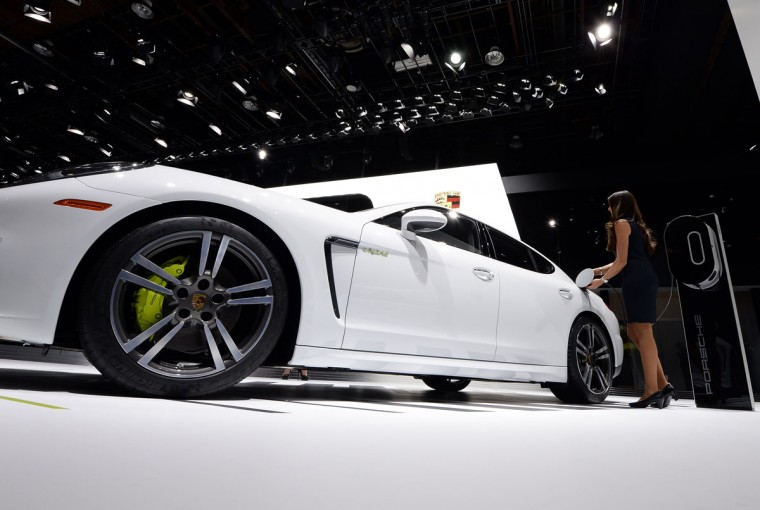 A woman connects the Porsche Panamera S to charge during the press preview of the 2016 North American International Auto Show in Detroit, Michigan, on January 12, 2016. (JEWEL SAMAD/AFP/Getty Images)