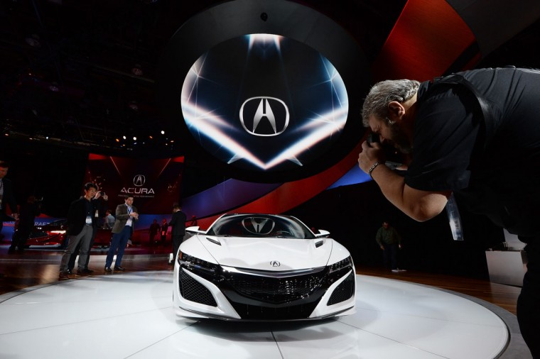 A man photographs the Acura NSX during the press preview of the 2016 North American International Auto Show in Detroit, Michigan, on January 12, 2016. (JEWEL SAMAD/AFP/Getty Images)