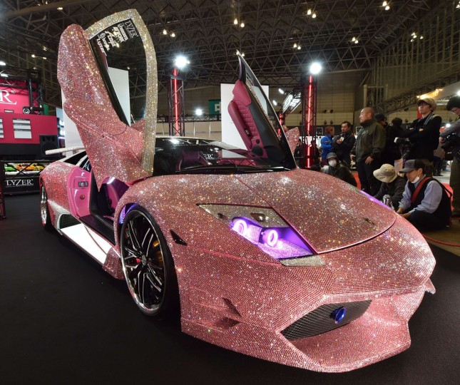 Japan's LED and HID parts manufacturer LYZER displays a demo car, the Lamborghini Murcielago finished with pink Swarovski crystals on the whole body, at Tokyo Auto Salon 2016 at Makuhari Messe in Chiba on January 15, 2016. The exhibition, one of the largest annual custom car and car-related product show, held here over the three-day period from January 15 to January 17. (AFP Photo/Kazuhiro Nogi)