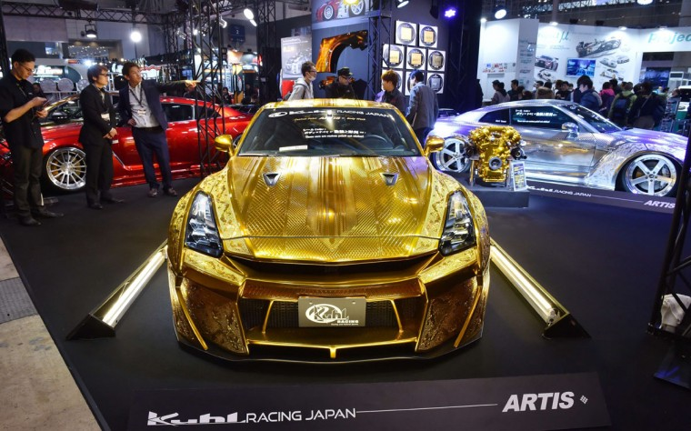 Japan's Kuhl racing and arts displays a custom car Project R35GT-R (C), painted with gold metal paint and 3D diamond block on the Nissan GT-R, at Tokyo Auto Salon 2016 at Makuhari Messe in Chiba on January 15, 2016. The exhibition, which is one of the largest annual custom car and car-related product shows, is being held from January 15 to January 17. (AFP Photo/Kazuhiro Nogi)